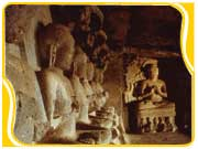 Seated Buddha statues line the walls of Cave 12 at the rock-cut temple in Ellora. Aurangabad